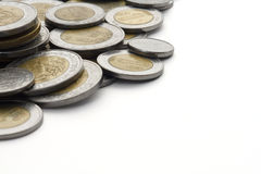 Mexican Peso Coins with White Copy Space. The edge of a pile of current, modern, Mexican Peso coins. Copy space has been left for the designer at the right side Royalty Free Stock Photos