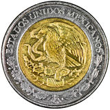 Mexican Peso. Mexican 1 Peso Gold and Silver Coin Obverse with the National Shield and lettering Estados Unidos Mexicanos Isolated Stock Image
