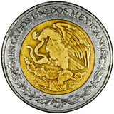 Mexican Peso. Mexican 5 Pesos Gold and Silver Coin Obverse with the National Shield and lettering Estados Unidos Mexicanos Isolated Stock Image