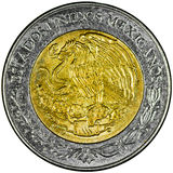 Mexican Peso. Mexican 2 Pesos Gold and Silver Coin Obverse with the National Shield and lettering Estados Unidos Mexicanos Isolated Royalty Free Stock Image