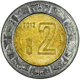 Mexican Peso. Mexican 2 Pesos Gold and Silver Coin Reverse showing the Ring of Serpents of the Aztec Isolated Royalty Free Stock Photos