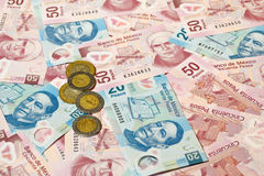 Mexican pesos. Background of Mexican pesos - 20 and 50 pesos bills and coins Stock Photo