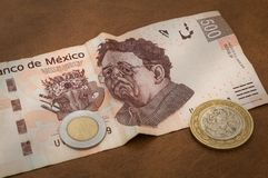 A 500 mexican pesos bill seems to be sad. The image of the mexican painter Diego Rivera, represented in a 500 mexican pesos bill, seems to be sad because of its Stock Photography