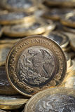 Mexican pesos currency on more coins in disorder, vertical Stock Photography