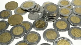 Mexican pesos, old and damaged Mexico coins. On white background Royalty Free Stock Photo