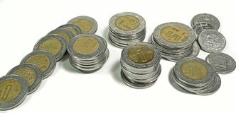 Mexican pesos, stacked coins of various denominations on white background. Editorial and illustrative image Stock Photography