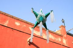 Mexican Piñata suspended in the Street with Blue Sky and royalty free stock images
