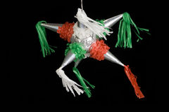 Mexican pinata. Decorated in red, green and white. Isolated on black background Stock Images