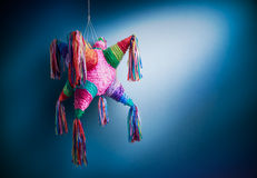 Mexican pinata used in posadas and birthdays. Colorful mexican pinata used in birthdays on a blue background Stock Photos