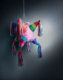 Mexican pinata used in posadas and birthdays. Colorful mexican pinata used in birthdays on a grey background Stock Photography