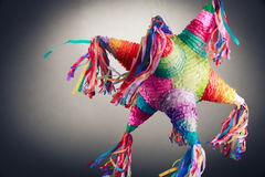 Mexican pinata used in posadas and birthdays. Colorful mexican pinata used in birthdays on a grey background Royalty Free Stock Photo