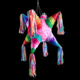 Mexican pinata used in posadas and birthdays. Colorful mexican pinata used in birthdays isolated on black Stock Images