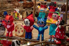Mexican Pinatas characters, crafts made with paper. Mexican Pinatas characters, crafts made with paper in a Mexican market stock photos