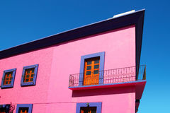 Mexican pink house facade  wooden doors Stock Photos