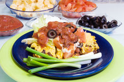 Mexican Pizza Casserole. Made with salsa, cheese, sour cream, tomato, black olives, lettuce and green onions Royalty Free Stock Photography
