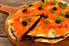 Mexican pizza close up on wooden server Stock Photo