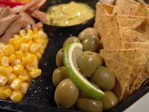 Mexican plate. Closeup with taco, olive, lime, corn, chicken, avocado sauce stock image