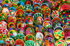 Mexican plates hand-decorated. Stand with small plates hand-decorated Mexican / many colors Royalty Free Stock Photography