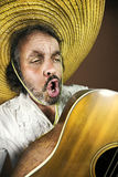 Mexican playing guitar and singing a song Royalty Free Stock Photography