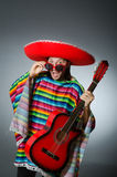 Mexican playing guitar wearing sombrero Royalty Free Stock Images