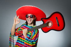 Mexican playing guitar wearing sombrero Stock Images