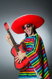 The mexican playing guitar wearing sombrero Stock Photo