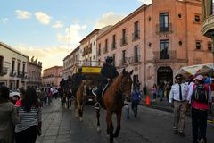 Mexican police on horse patrol at Festival. Zacatecas, Mexico, 02 August 2013: Mexican police with guns on horses patrol the colonial center at the 18th Festival Stock Photography