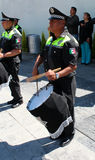Mexican police officer plays drums Royalty Free Stock Photography