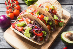 Mexican pork tacos. With vegetables on wooden rustic background . Top view stock images