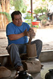A mexican potter working on a vase in San Bartolo Coyotepec Royalty Free Stock Images