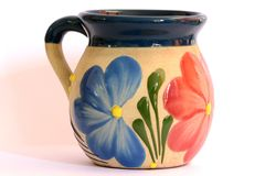 Mexican pottery, cup with floral decoration Royalty Free Stock Photo