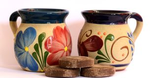 Mexican pottery, cup with floral decoration Stock Photos