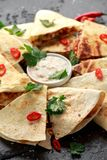 Mexican quesadilla with chicken, cheese and peppers, yogurt dip and chilli. stock photography