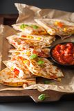 Mexican quesadilla with chicken, tomato, sweet corn and cheese stock photo