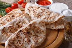 Mexican quesadilla  and sauces horizontal top view Royalty Free Stock Image