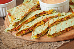 Mexican Quesadilla sliced with vegetables royalty free stock images