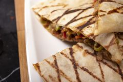 Quesadilla. Mexican quesadilla with squash blossom, cheese and spicy sauce in mexico city royalty free stock photos