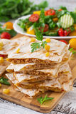 Mexican Quesadilla wrap with chicken, corn and sweet pepper. And fresh salad Stock Photo