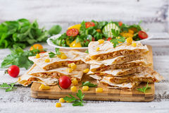 Mexican Quesadilla wrap with chicken, corn and sweet pepper. And fresh salad Royalty Free Stock Photography