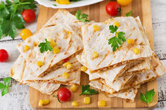 Mexican Quesadilla wrap with chicken, corn and sweet pepper. And fresh salad Stock Image
