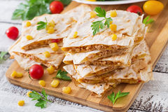 Mexican Quesadilla wrap with chicken, corn and sweet pepper. Mexican Quesadilla wrap with chicken, corn and sweet pepper and fresh salad Stock Photography