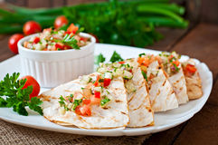 Mexican Quesadilla wrap with chicken, corn and sweet pepper. And salsa royalty free stock image