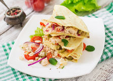 Mexican Quesadilla wrap with chicken,. Olives, sweet pepper and salad stock image