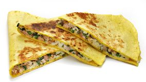 Mexican quesadillas with cheese, vegetables and salsa isolated. On a white background Stock Photos