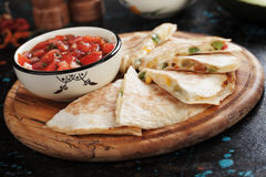 Mexican quesadillas with home made salsa. Mexican quesadillas, cheese filled tortilla slices with home made salsa Royalty Free Stock Photo