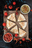 Mexican quesadillas with salsa and guacamole Royalty Free Stock Images