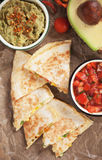 Mexican quesadillas with salsa and guacamole Royalty Free Stock Photos