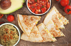 Mexican quesadillas with salsa and guacamole. Mexican quesadillas, cheese filled tortilla wraps with salsa and guacamole Stock Photography