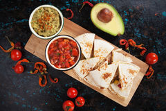 Mexican quesadillas with salsa and guacamole Royalty Free Stock Image