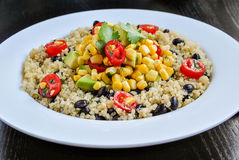 Mexican Quinoa Salad. With Avocado cherrie tomatoes and black beans Royalty Free Stock Photo
